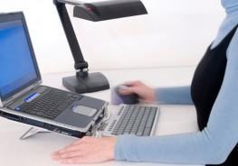Lady on Ergo Keyboard Laptop